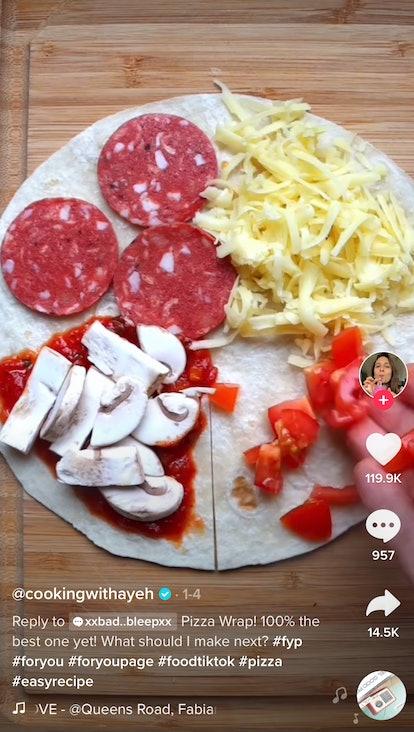 A woman assembles a pizza wrap on a tortilla for TikTok.