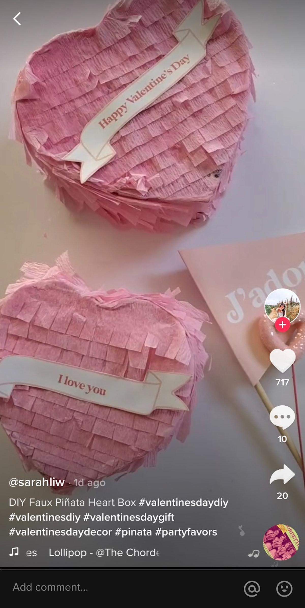 A TikTok user creates a heart-shaped piñata for a DIY Valentine's Day gift.