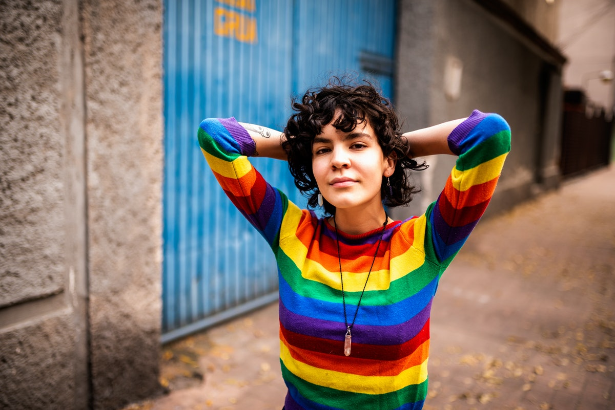 Young woman with rainbow sweater