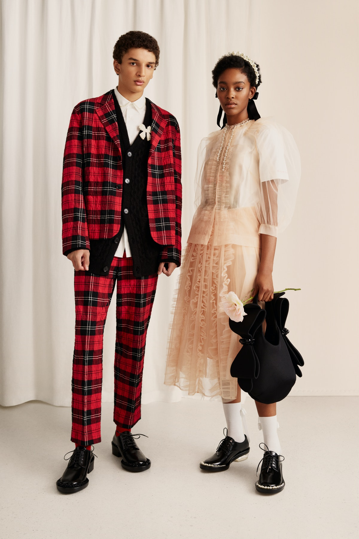 Models wearing Simone Rocha x H&M's collection.