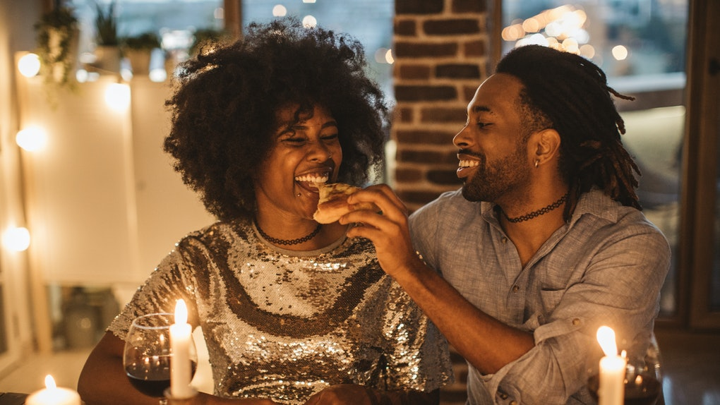 Couple eating pizza on date night at home