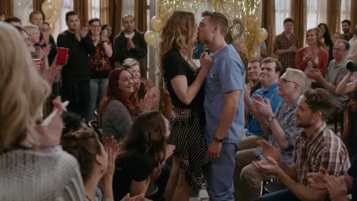 Alexis Rose and Ted kiss during Singles Week on 'Schitt's Creek.'