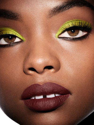 Model wears green eyeshadow, one of summer 2021's biggest makeup trends