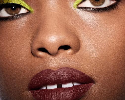 Model wears green eyeshadow, one of summer 2021's biggest makeup trends