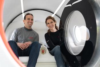 Josh Giegel and Sara Luchian sitting inside a Virgin Hyperloop passenger pod.