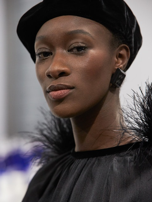 Model poses backstage at the Giorgio Armani Fall/Winter 2021 show during Milan Fashion Week.