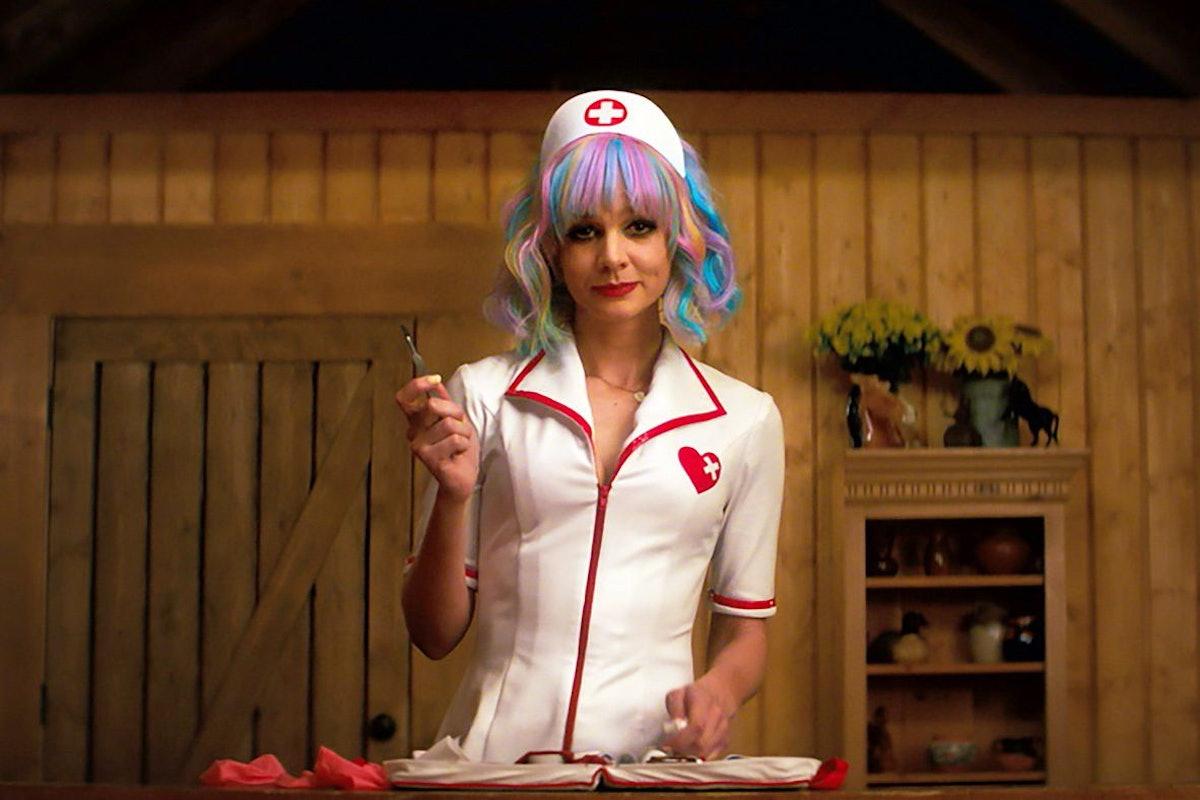 Carey Mulligan in a nurse uniform.