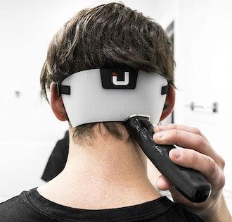 U.A.A. INC. Neckline Shaving Template