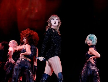 Taylor Swift in black on stage.