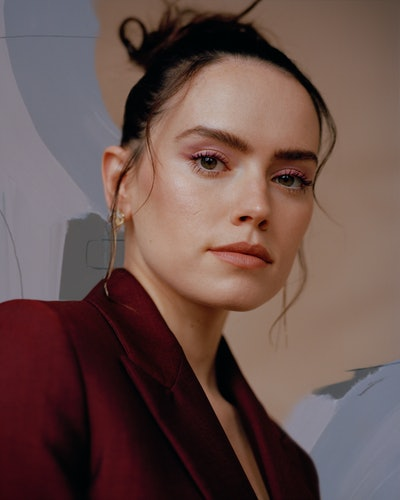 A closeup of Daisy Ridley wearing a red suit on the cover of TZR's spring 2021 issue.