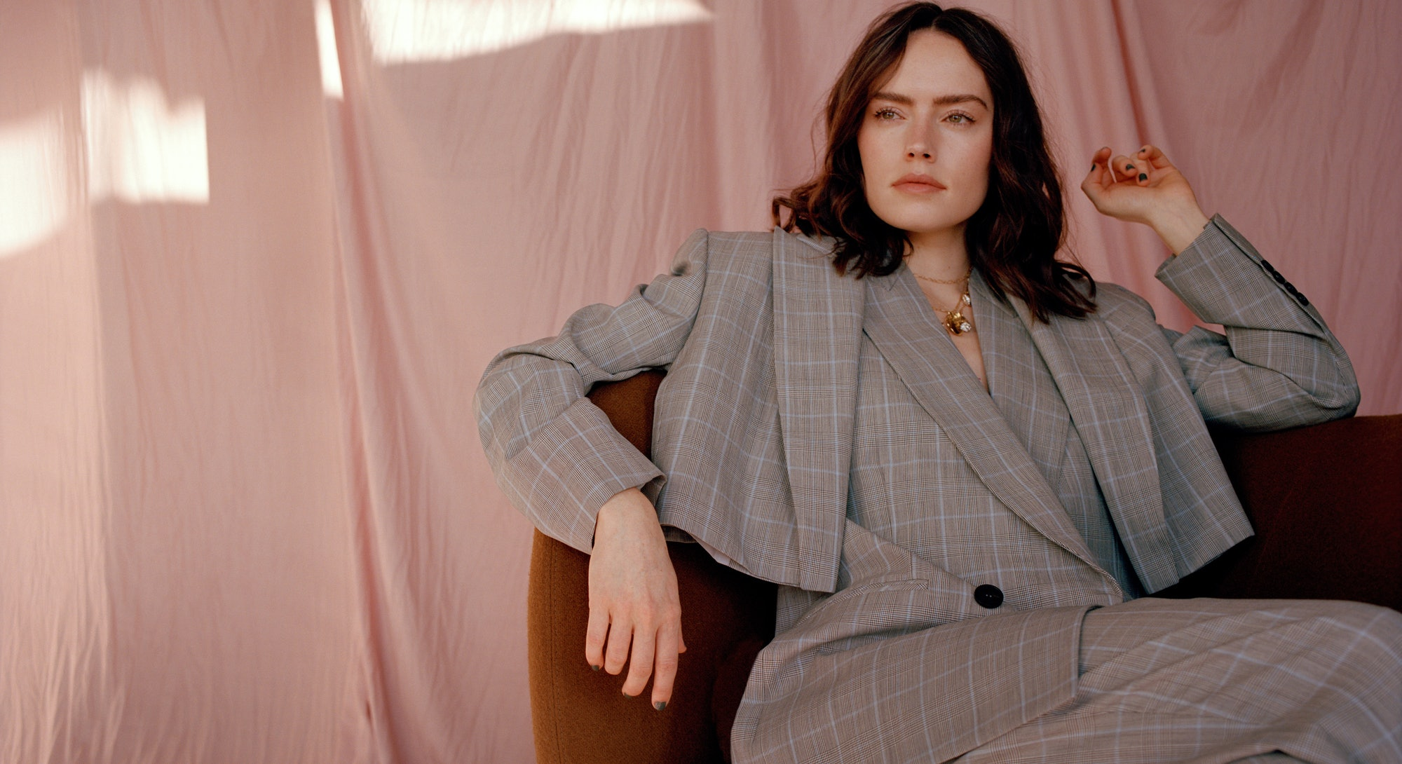 Daisy Ridley appears on the cover of TZR's spring 2021 issue wearing a gray Alexander McQueen suit.
