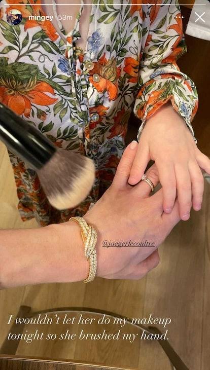 Amanda Seyfried's daughter Nina helps her get ready.