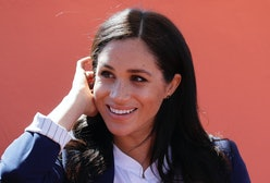 Meghan, Duchess of Sussex attends an Investiture for Michael McHugo the founder of 'Education for Al...
