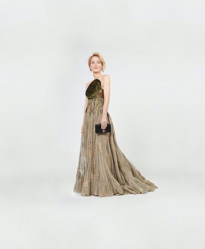 Gillian Anderson's floor-length gown was a golden sheer design.
