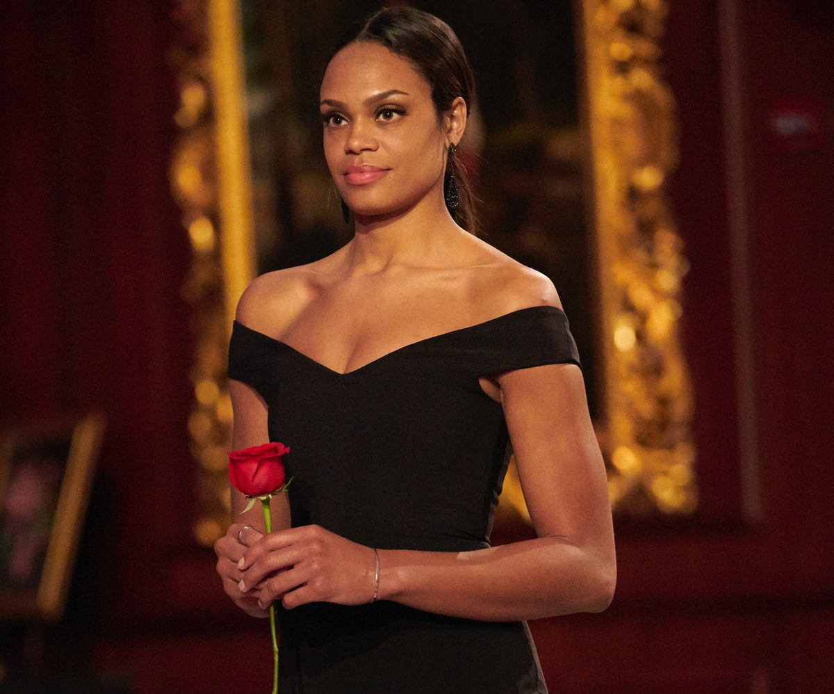 Bachelorette Michelle Young holding a red rose