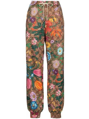 Flora GG Supreme pattern track pants