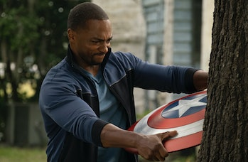 Anthony Mackie holding the Captain America shield in The Falcon and the Winter Soldier