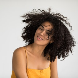 How to restore your hair's natural curl pattern, according to experts.