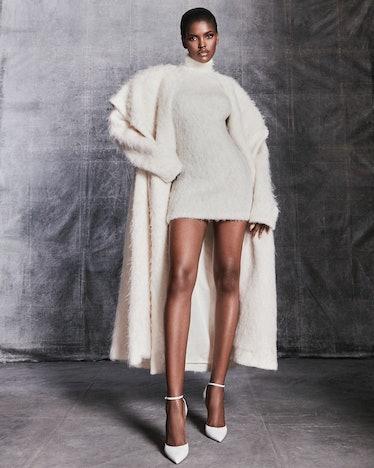 model in white knit dress