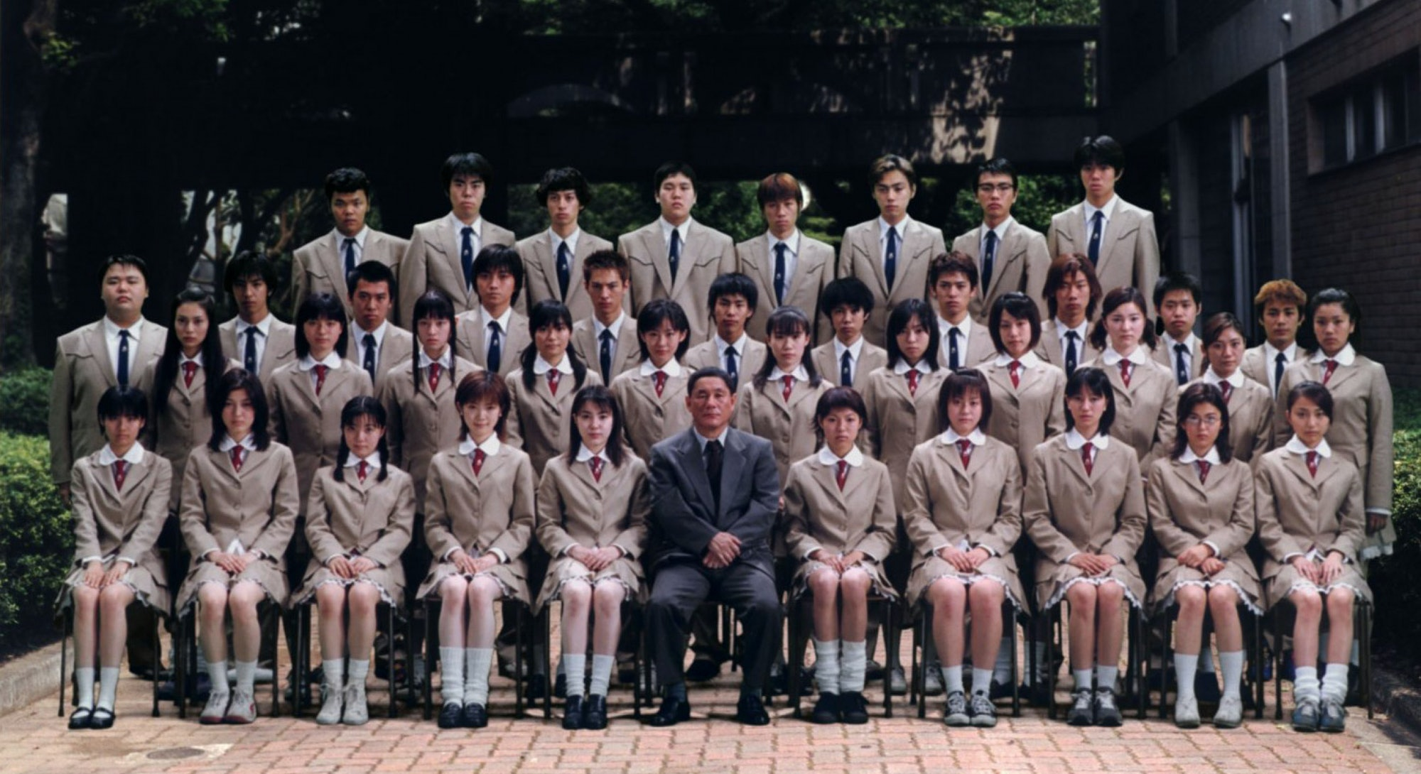 still from battle royale class of japanese students in uniform sitting for photo