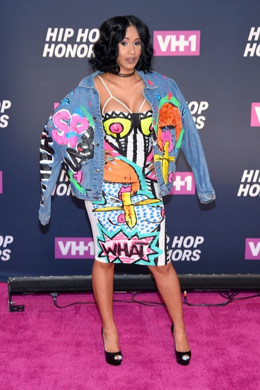 Cardi B in graffiti-covered outfit.