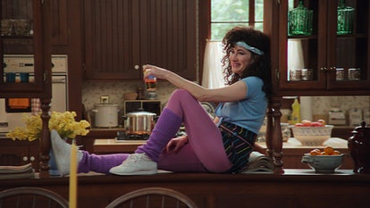 Kathryn Hahn as Agatha, sitting on the kitchen counter in '80s clothes, being wonderful