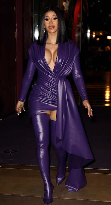 Cardi B in purple dress and boots.