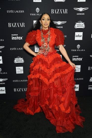 Cardi B in a ruffled red dress.