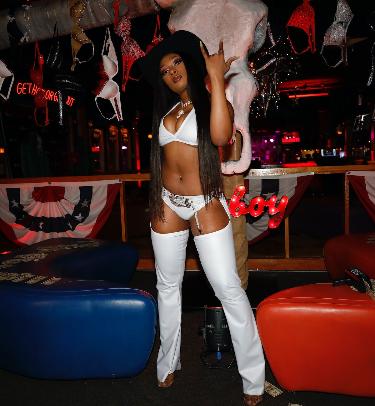Megan Thee Stallion in white chaps and a cowboy hat