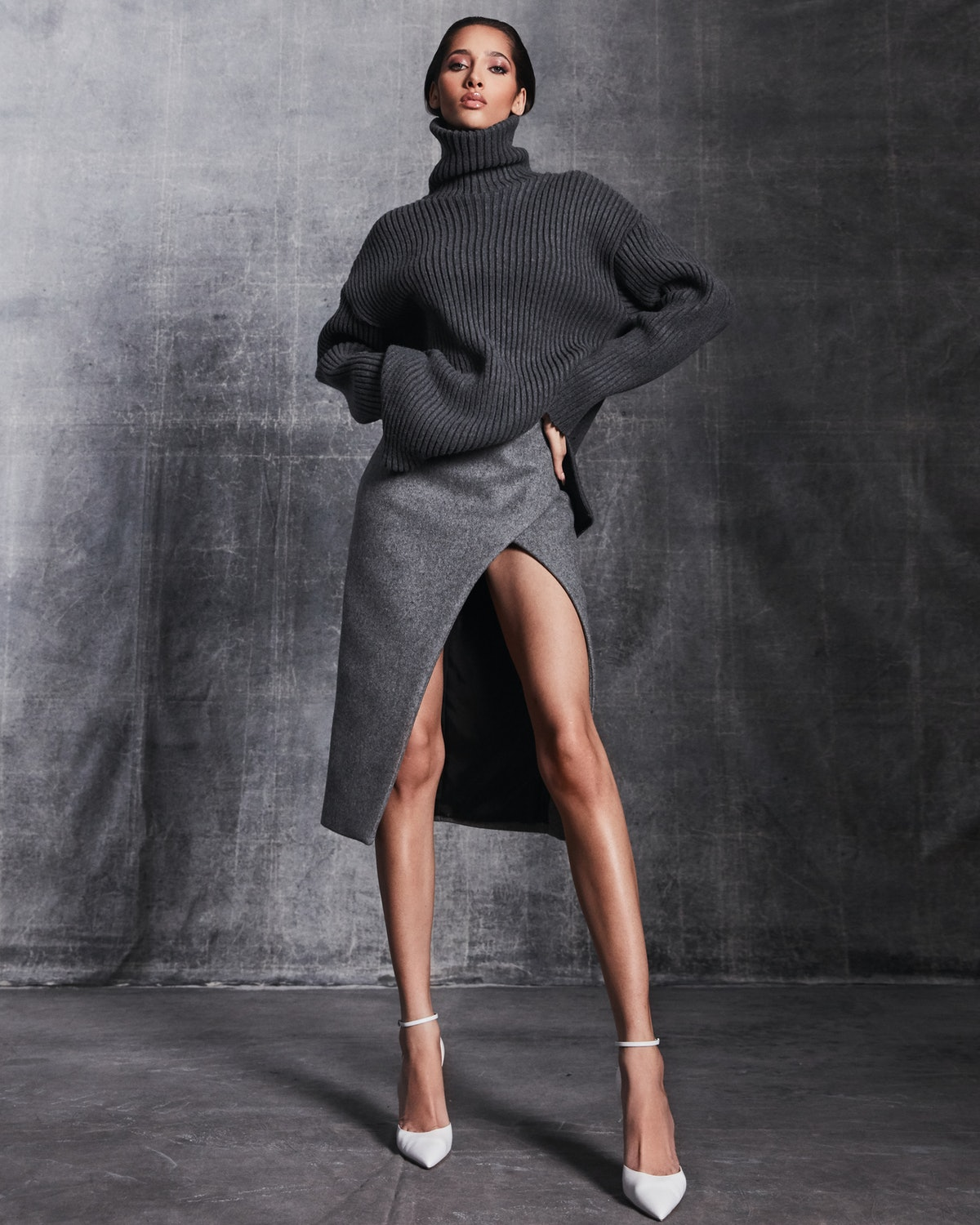 model in gray skirt and sweater