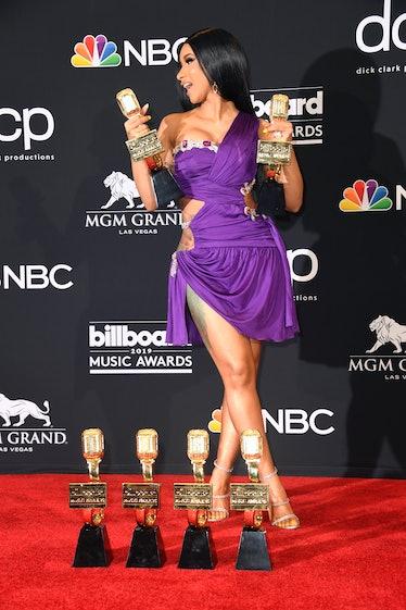 Cardi B in purple mini-dress.