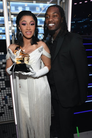 Cardi B in white gown at Grammys.