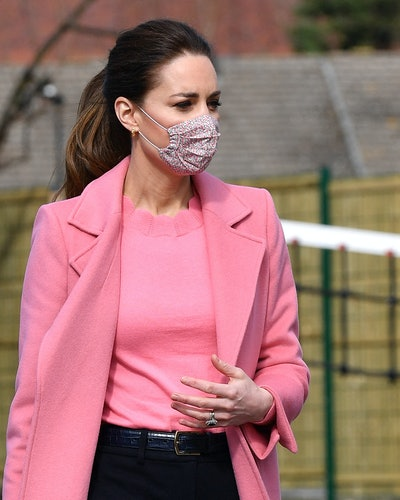 Britain's Catherine, Duchess of Cambridge gestures during a visit to School21 following its re-opening after the easing of coronavirus lockdown restrictions in east London on March 11, 2021.