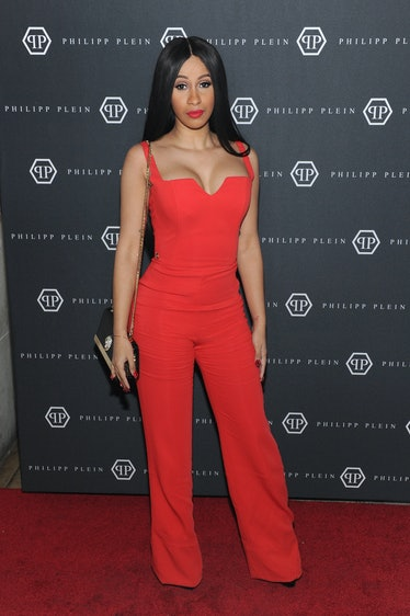 """Cardi B in red jumpsuit, giving """"Cher"""" vibes."""