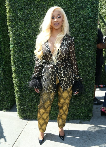 Cardi B in mismatched, funky patterned separates.