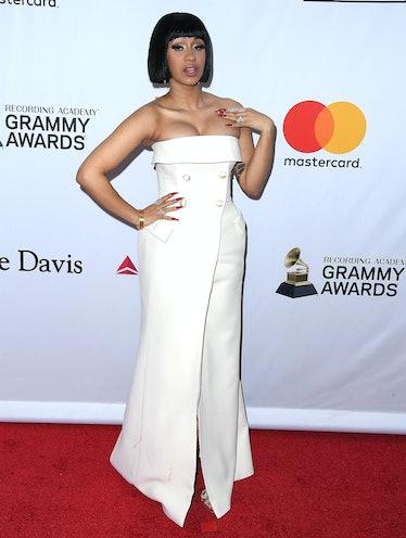 Cardi B in a chic, simple white dress.