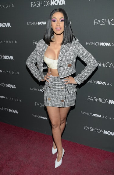 Cardi B in check suit, giving business woman vibes.