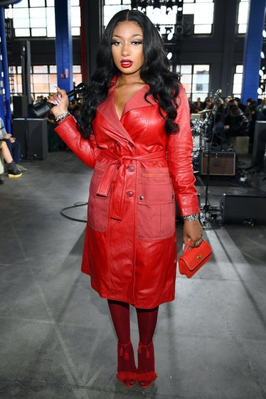 Megan wearing all red Coach leather at fashion week