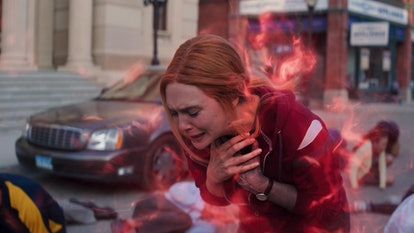 Wanda choking on her red mist powers, realizing she must choose between hurting people and her kids