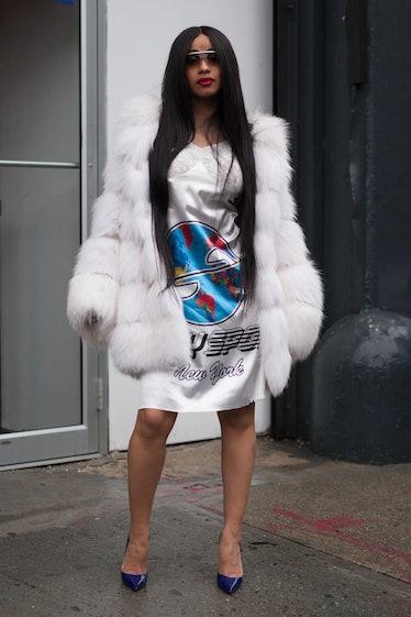 Cardi B in white fur coat.