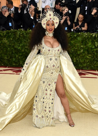 Cardi B in a dress that is giving holy saint vibes.