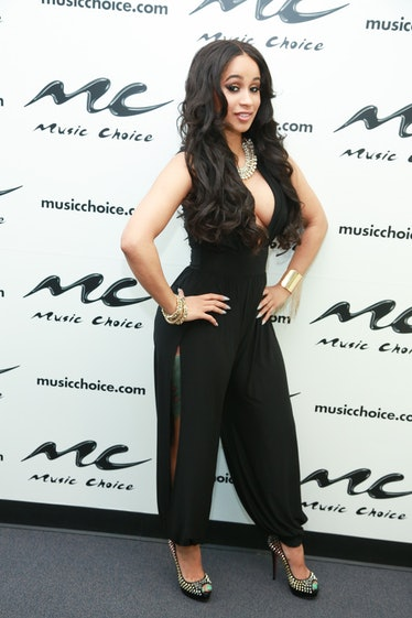 Carrdi B wears a simple black jumpsuit.