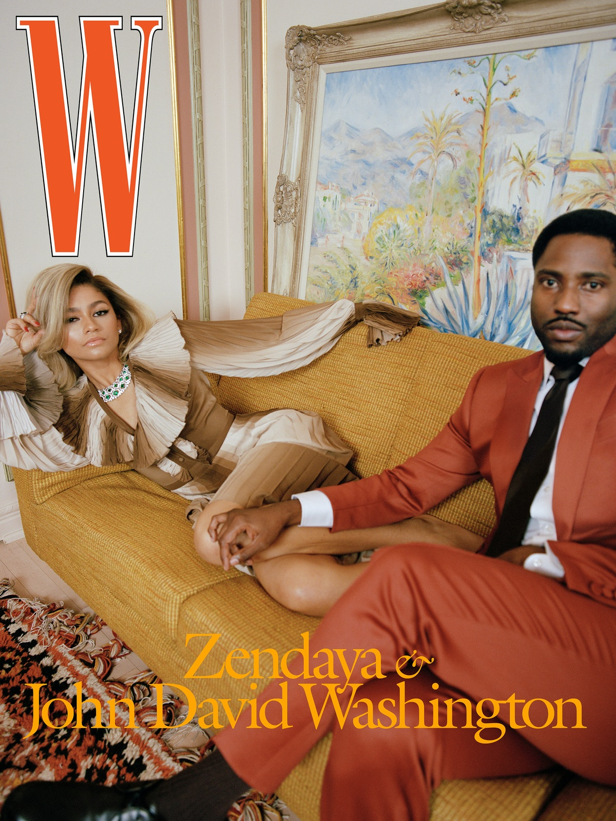 Zendaya wears a Gucci dress; Bulgari earrings, necklace, and ring. John David Washington wears a Frère suit, shirt, and tie; Falke socks; Dolce & Gabbana shoes.