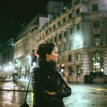 Young woman in London at night
