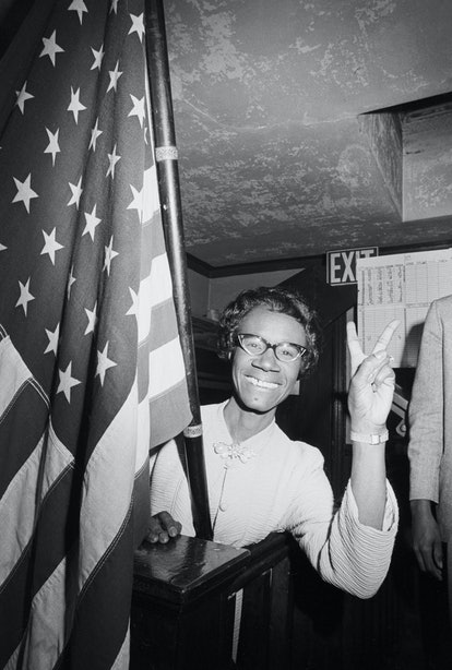 American politician Shirley Chisholm smiles and gives a victory sign after winning the Congressional election in Brooklyn's 12th District, November 5, 1968. In her victory, she become the first African-American woman elected to Congress.