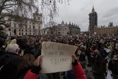 LONDON, UNITED KINGDOM - MARCH 14, 2021: Protesters gather in Parliament Square to demonstrate against the Met Polices handling of a vigil held for Sarah Everard yesterday in Clapham Common and to rally against the governments proposed policing bill, which would give officers and the home secretary new powers to impose conditions on protests and public processions, on 14 March, 2021 in London, England.