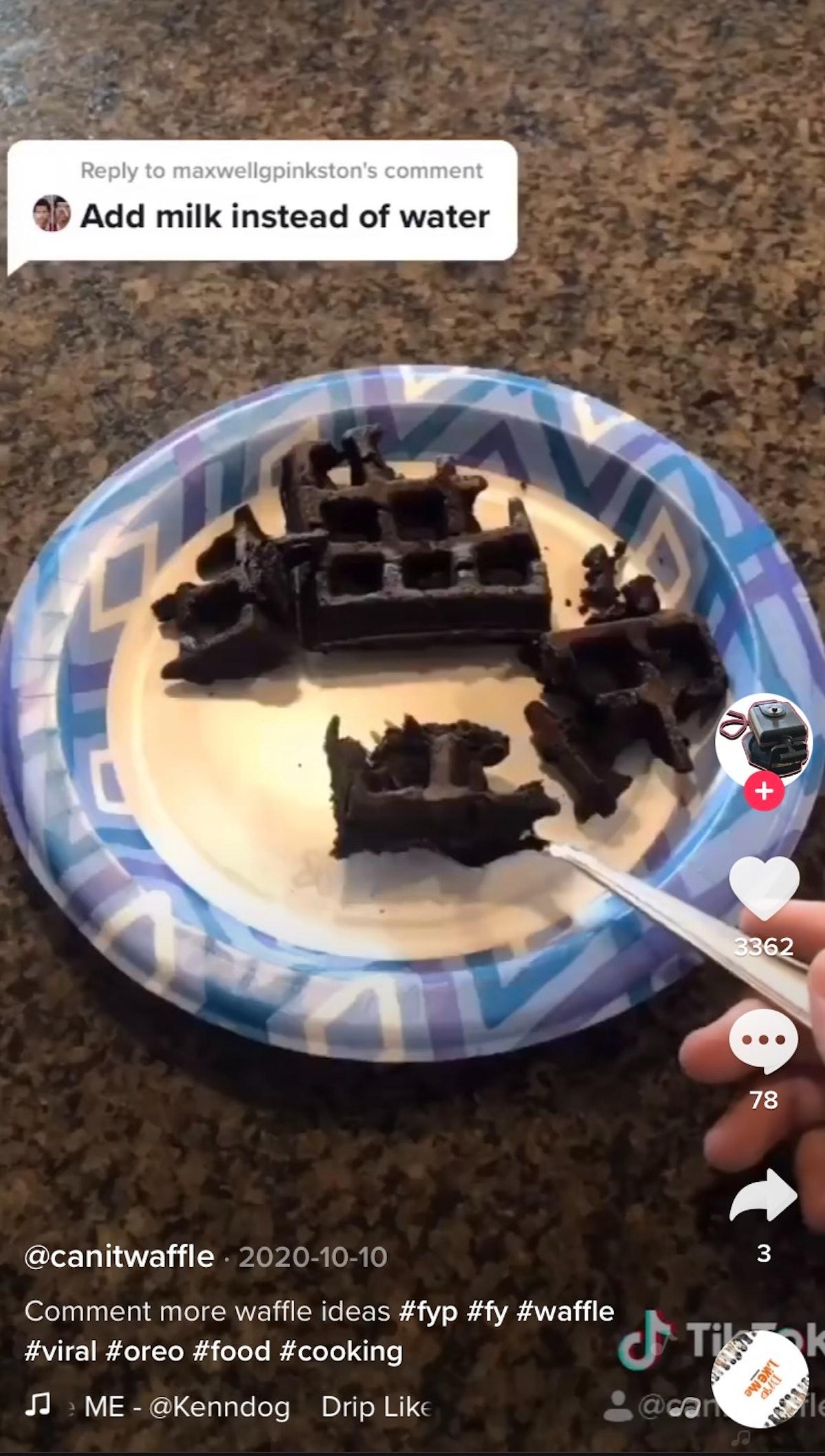 A man makes some chocolate Oreo waffles for TikTok.