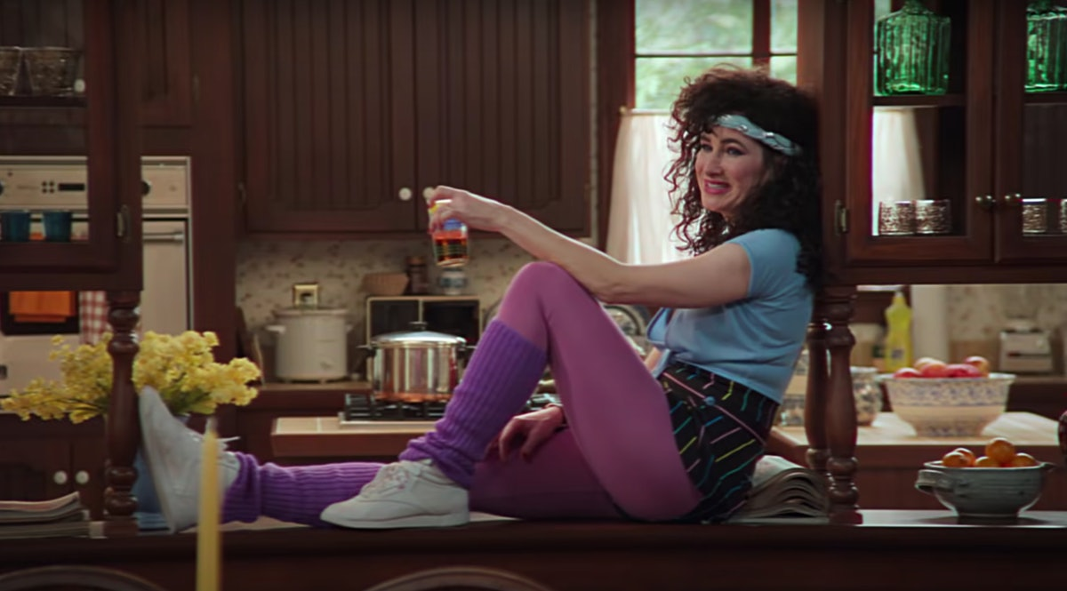 Agnes sits on the kitchen counter in '80s jazzercise clothes in 'WandaVision.'
