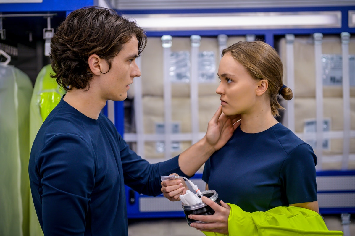 Fionn Whitehead touching Lily-Rose Depp's face