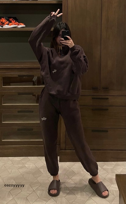 Kendall Jenner in an all-brown sweatsuit.